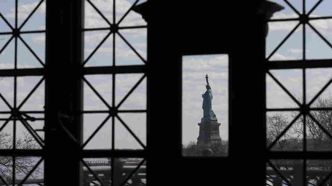 The Statue of Liberty, as seen through windows on the south side of the Great Hall at Ellis Island.