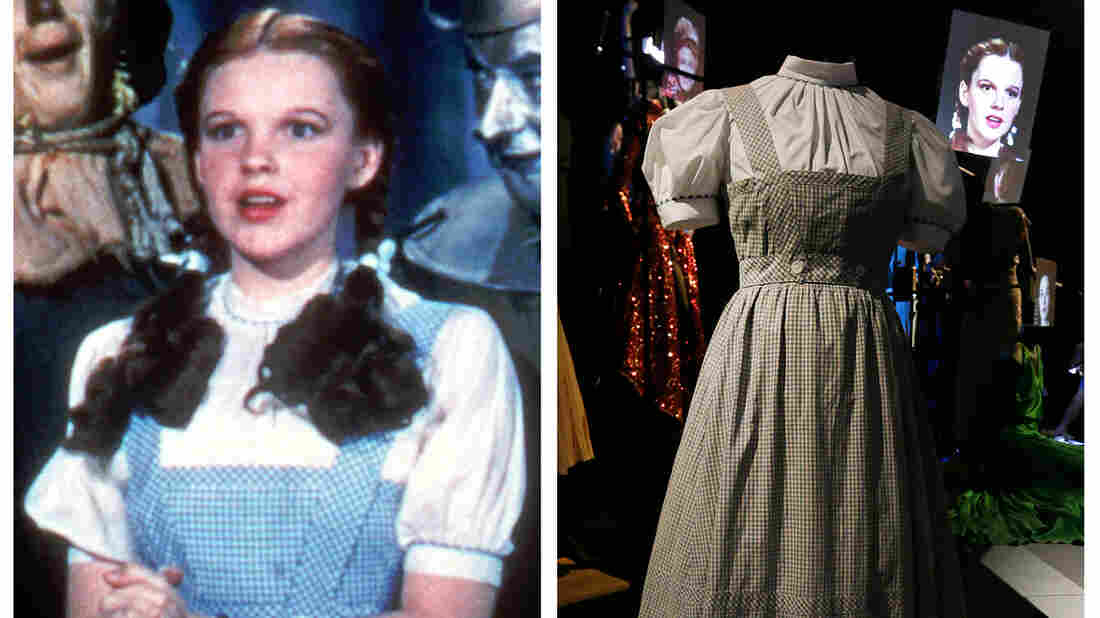 Judy Garland is seen as Dorothy in Wizard of Oz, wearing her blue and white dress, and one of the dresses made for the movie is displayed in London.