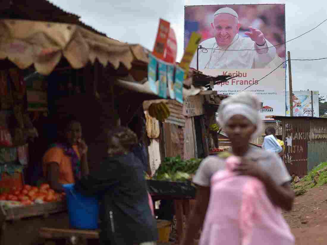 A poster in the Nairobi slum of Kangemi welcomes Pope Francis to Kenya.