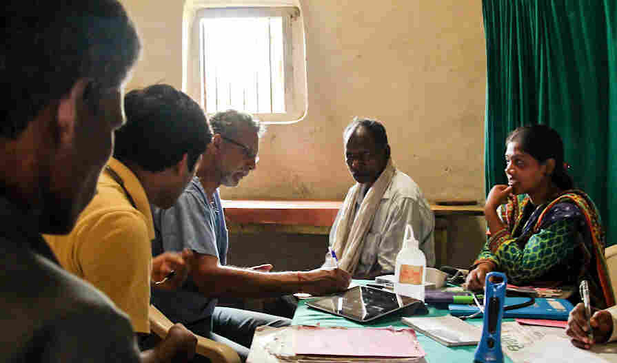 Dr. Raju Rao, in glasses, during his volunteer stint in India.