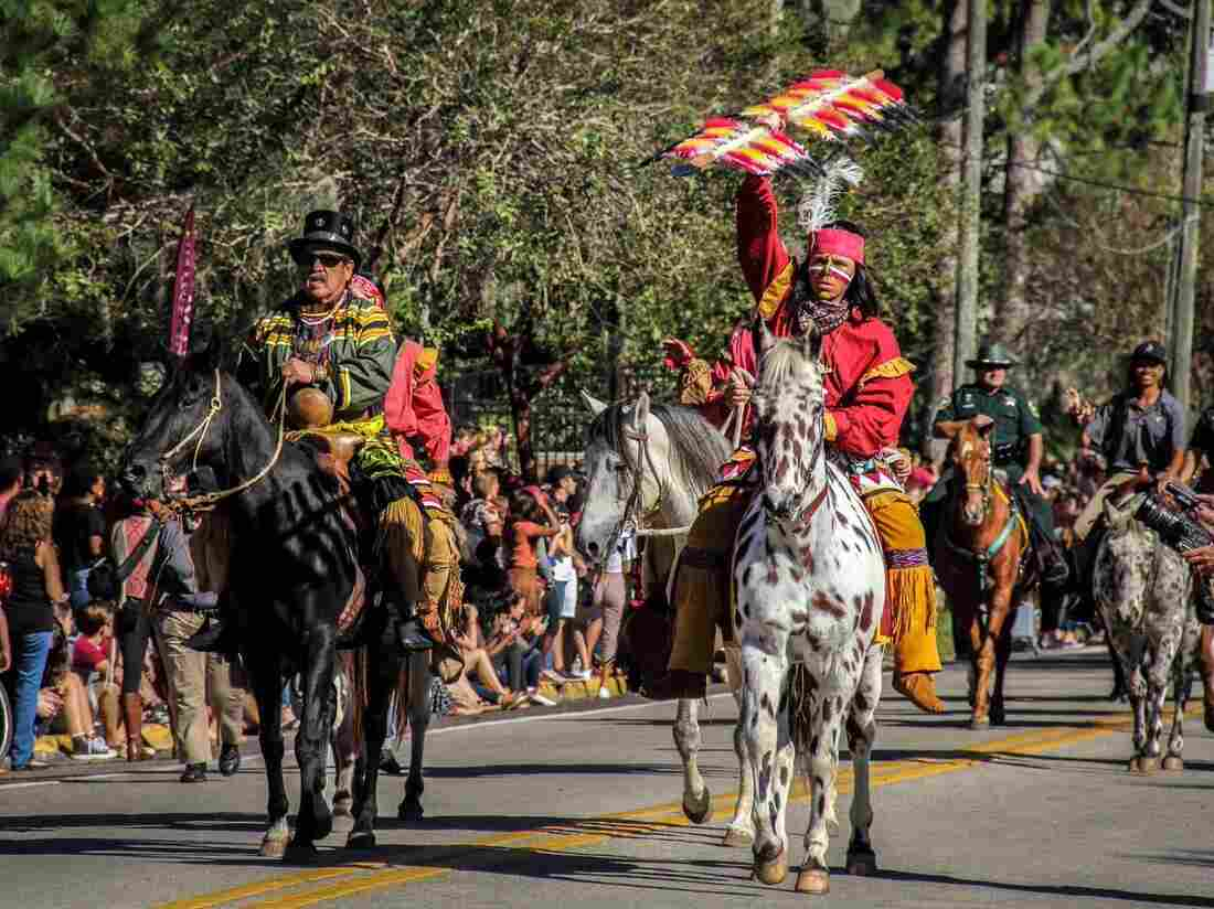 """Moses Jumper, a Seminole re-enactor from Big Cypress and """"Osceola"""" lead the 2015 FSU Homecoming parade."""