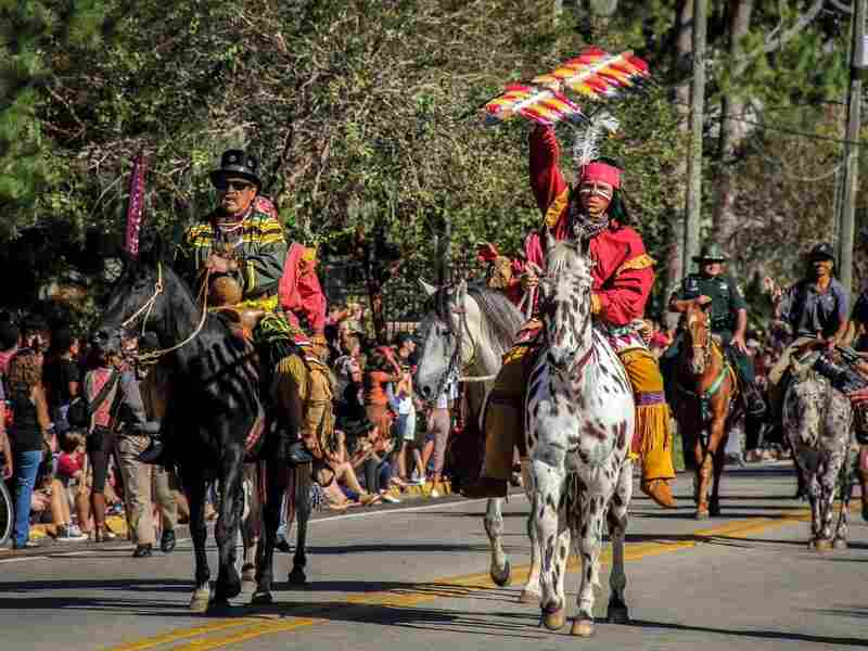 Moses Jumper, a Seminole re-enactor from Big Cypress Reservation, and an FSU student portraying Osceola lead the 2015 FSU Homecoming parade.