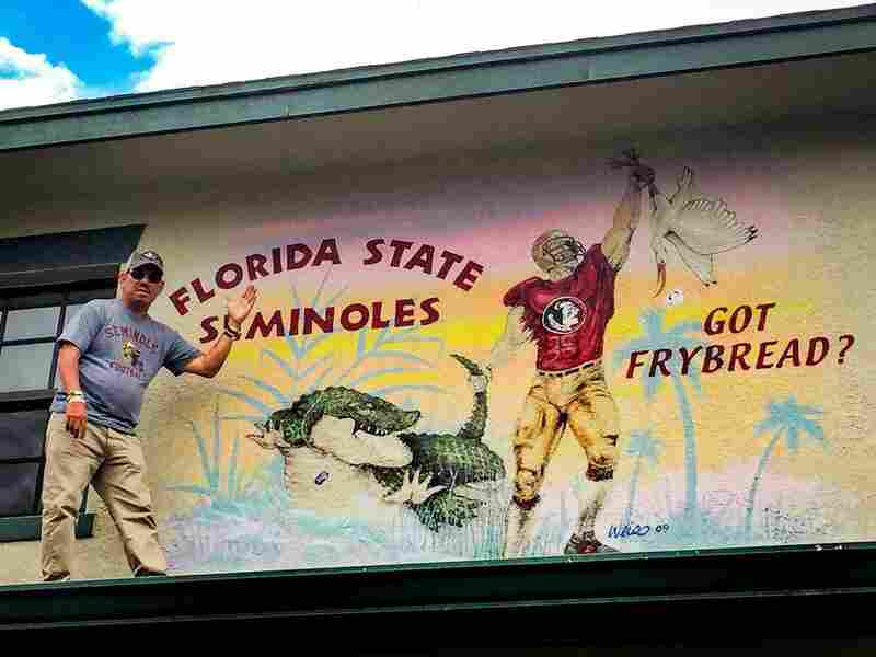 Skeeter Bowers, 48, is assistant to the chairman of the Seminole Tribe of Florida. He's so proud of FSU and Osceola that he has murals painted on his house on the Brighton Reservation, Okeechobee, Florida. This one shows FSU's dominance over the University of Florida Gators and the University of Miami Hurricanes. As for fry bread, it's a Seminole specialty.