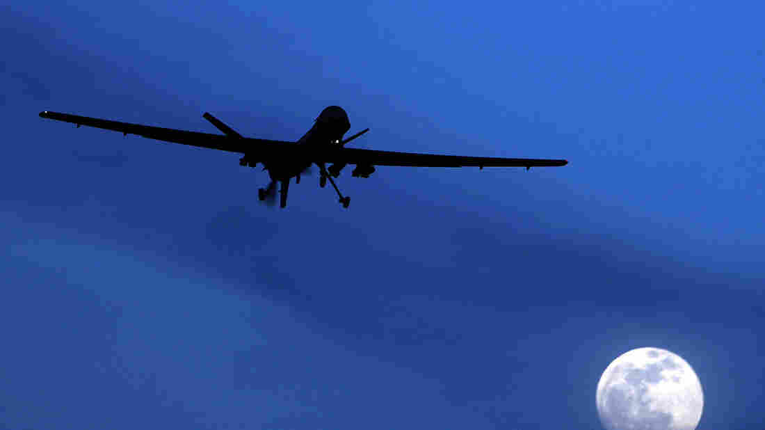 An unmanned U.S. Predator drone flies in January 2010 over Kandahar Air Field, southern Afghanistan, on a moon-lit night.