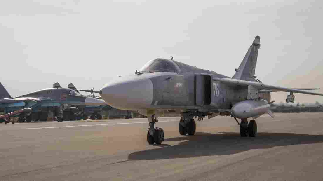 A Russian warplane taxies at Hemeimeem airbase in Syria. Advocates say a no-fly zone would keep Syrian aircraft from attacking anti-government rebels and endangering civilians, which might allow Syrians to feel safe enough to stay put.