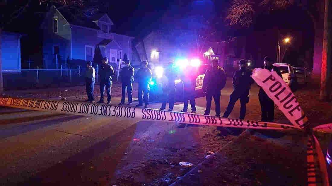 Minneapolis police cordoned off a section of road in north Minneapolis late Monday night after five people were shot.