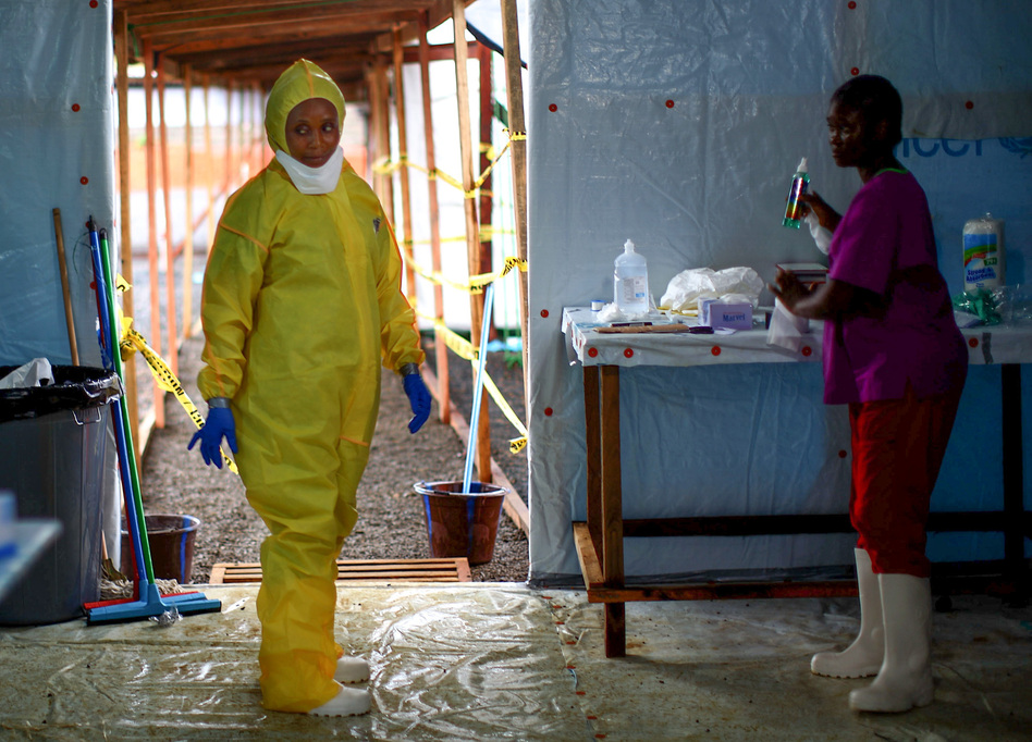 Some health workers in Liberia had stopped using the protective gear that was part of the Ebola routine. The photo above is from 2014, when the epidemic was at its peak. (David P. Gilkey/NPR)