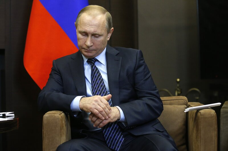 "Russian President Vladimir Putin is shown during a meeting with Jordan's King Abdullah II in Sochi, Russia, on Tuesday. Putin said Turkey's downing of a Russian warplane was ""a stab in the back."" (Maxim Shipenkov/AFP/Getty Images)"