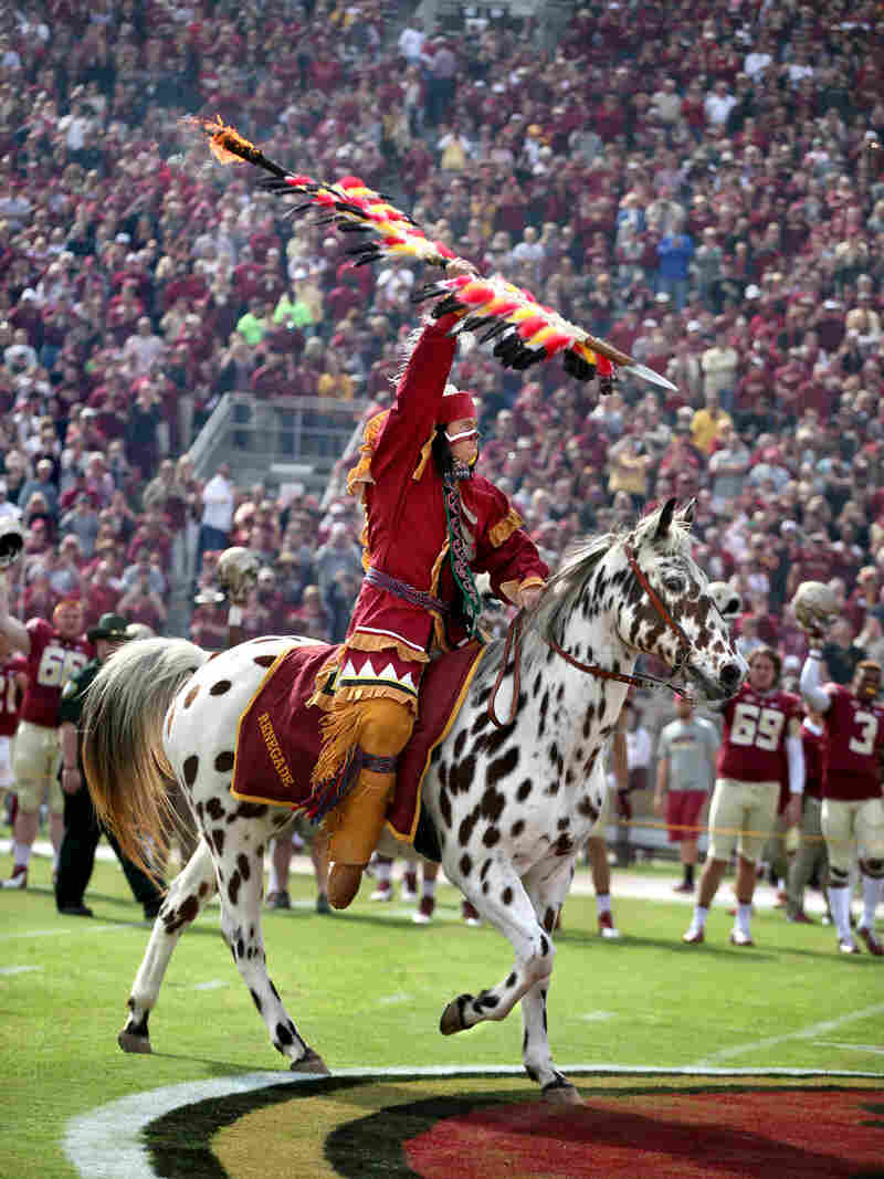 The student portraying Osceola wields his flaming torch at the FSU homecoming game.