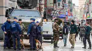 Brussels Cautiously Opens For Business As Search For Suspects Continues