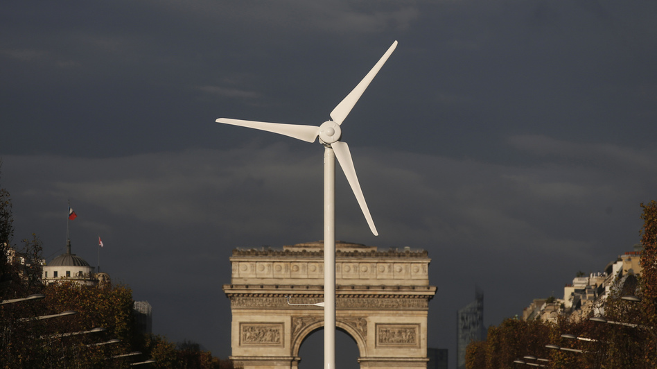 A power-generating windmill turbine is seen in front of the Arc de Triomphe on the Champs Elysees avenue in Paris ahead of the COP21 World Climate Summit, which begins Monday. (Christian Hartmann/Reuters /Landov)