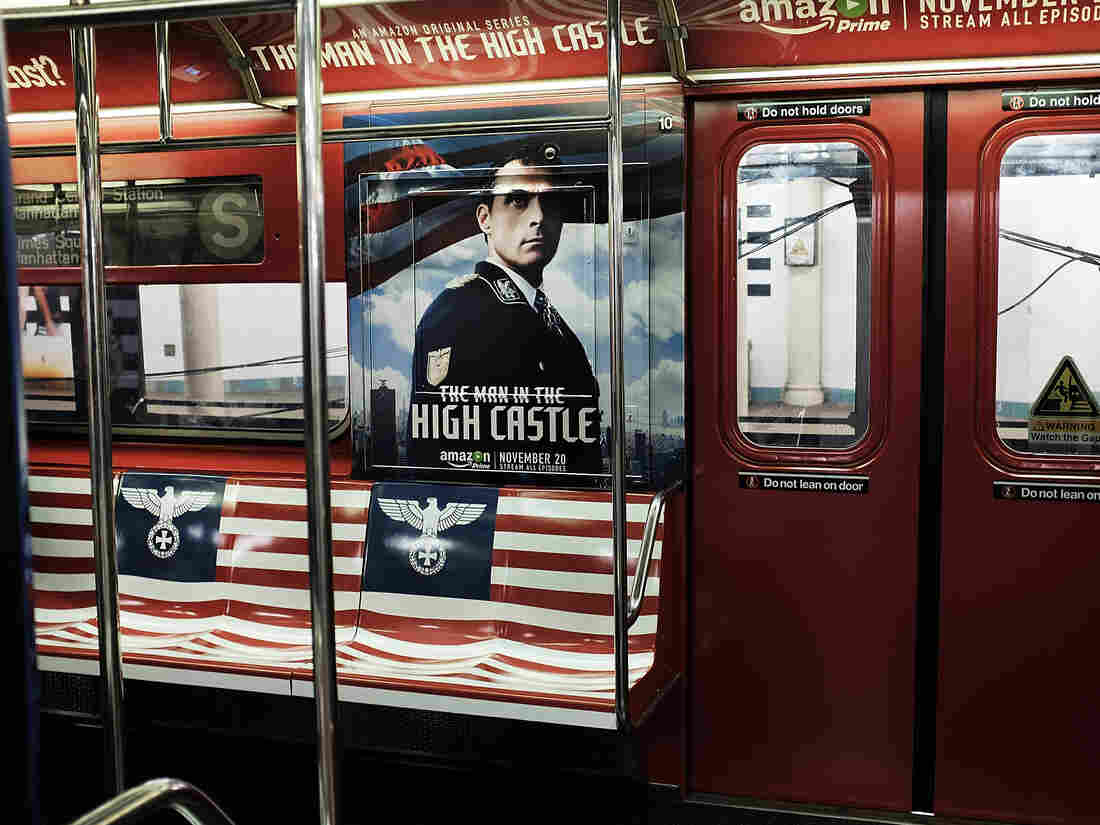 A New York City subway car is covered in Nazi imagery to promote the new Amazon television series The Man in the High Castle. In this photo, the Nazi eagle appears on the American flag where the stars should be.