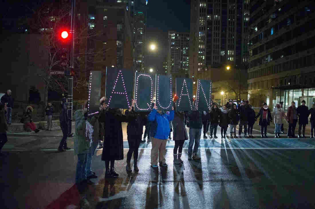 Demonstrators march through downtown Chicago on Tuesday following the release of a video showing Jason Van Dyke, a police officer, shooting and killing Laquan McDonald. Van Dyke is charged with first-degree murder for the October 2014 shooting in which McDonald was hit with 16 bullets. So far this year, 15 officers have been charged with murder or manslaughter resulting from an on-duty shooting.