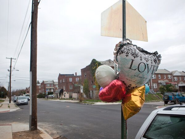 A memorial is seen on West Baltimore street at the site of the city's 300th homicide this year, Wednesday, Nov. 19, 2015 in Baltimore, MD. (Jun Tsuboike/NPR)