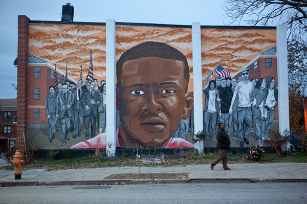 A mural for Freddie Gray is seen at the intersection of North Mount and Presbury streets where he was arrested in April. (Jun Tsuboike/NPR)