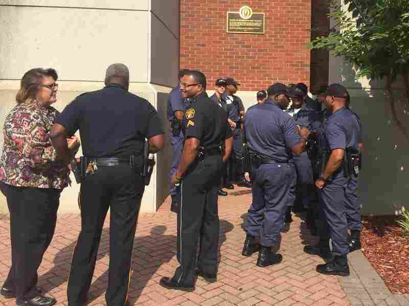 """Montgomery police cadets gathered outside the Rosa Parks Museum before a tour.  The tour is part of a course called """"Policing in a Historic City: Civil rights and Wrongs in Montgomery."""""""