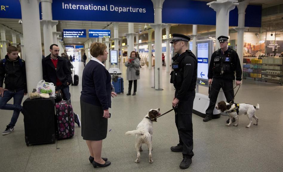 British police dog handlers patrol a train station in London in January. (Matt Dunham/AP)