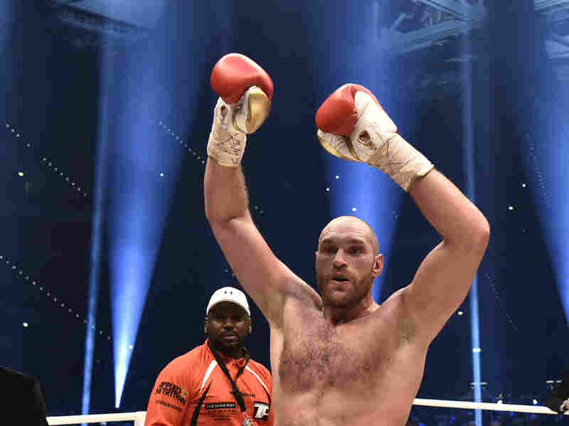 Britain's Tyson Fury celebrates after winning in a world heavyweight title fight for Ukraine's Wladimir Klitschko's WBA, IBF, WBO and IBO belts in the Esprit Arena in Duesseldorf, western Germany.
