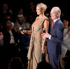 Project Runway host Heidi Klum and Tim Gunn at the Project Runway Spring 2013 fashion show in New York City. Today, Gunn is comfortable before an audience — but it wasn't always that way.