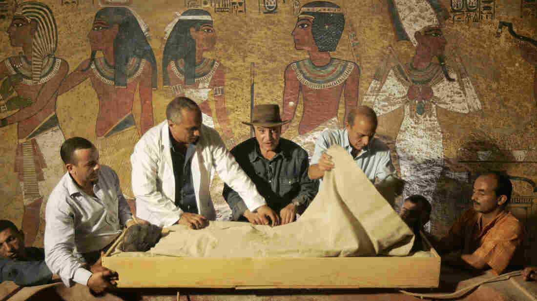 Officials remove the linen-wrapped mummy of King Tutankhamun from his stone sarcophagus in his underground tomb in the famed Valley of the Kings in Luxor in 2007. New radar scans show that other rooms may be hidden behind the tomb's walls.