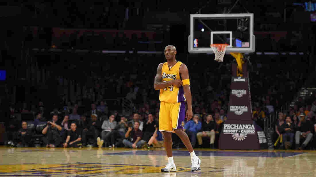 Los Angeles Lakers forward Kobe Bryant stands on the court during the second half of an NBA basketball game against the Denver Nuggets in early November. On Sunday, Bryant announced this season would be his last, in a poem posted online.