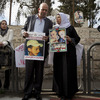 Hussein and Suha Abu Khdeir (center), parents of 16-year-old Palestinian victim Mohammed Abu Khdeir, hold posters with their son's portrait after the verdict was read in Jerusalem.