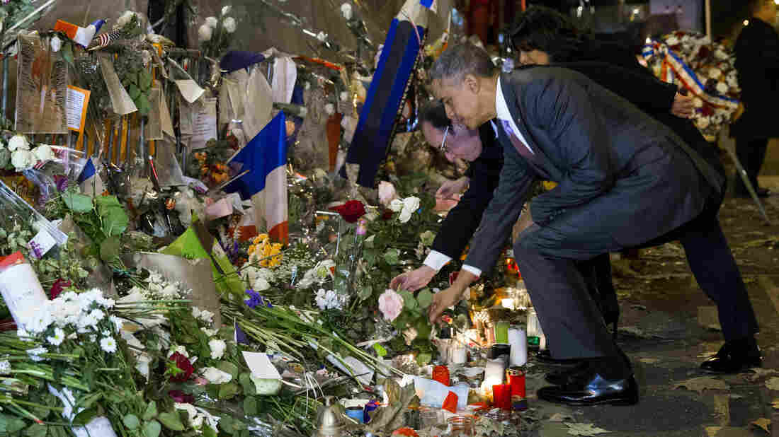 President Obama and French President Francois Hollande place flowers at the Bataclan, site of one of the Paris terrorists attacks. Obama is in Paris for a climate-change conference.