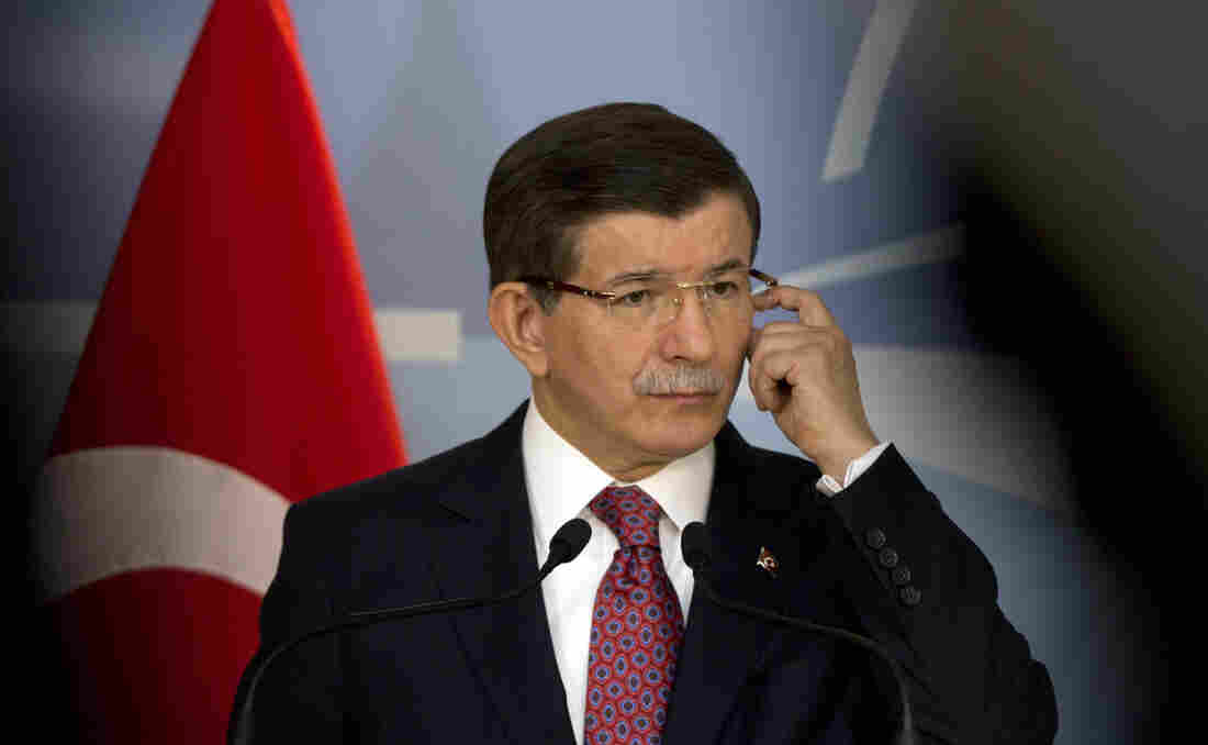 Turkish Prime Minister Ahmet Davutoglu speaks during a media conference Monday at NATO headquarters in Brussels.