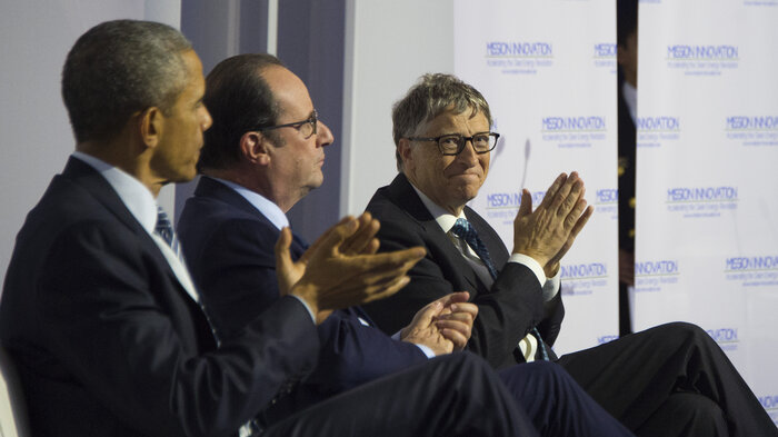 FROM LEFT: President Obama, French President Francois Hollande and Microsoft co-founder Bill Gates applaud a speech during the Mission Innovation event at the UN conference on climate change Monday in Paris. (Jim Watson/AFP/Getty Images)
