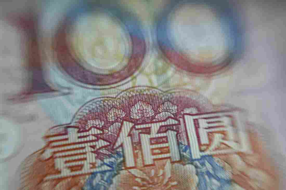 This photo illustration shows a Chinese 100-yuan note.