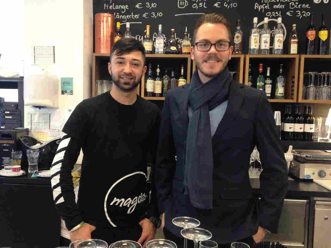 Sebastiaan De Vos, right, the general manager of Vienna's Magdas Hotel, recruits refugees like 24-year-old Ehsan Amini, left, to work at the hotel. Amini, who works in the Magdas cafe, fled Afghanistan and arrived in Austria five years ago. He's one of 20 refugees staffing the hotel.