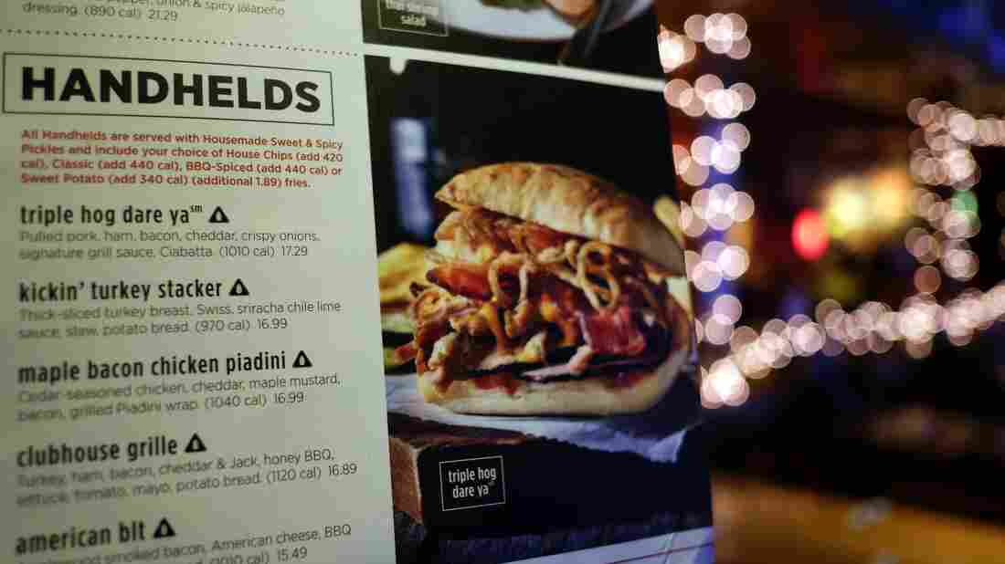 That black triangle icon is a sodium warning label next to a dish on the menu at an Applebee's in New York City. Starting Tuesday, the city's Health Department is requiring chain restaurants with 15 or more locations to display the salt shaker icon next to menu items containing 2,300 mg or more of sodium — the recommended daily limit.