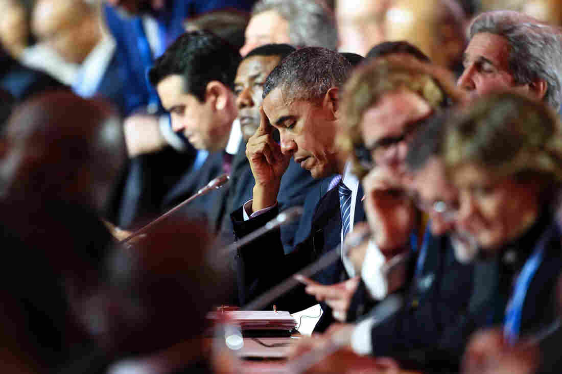 President Obama attended the plenary session of the international climate conference Monday, just outside Paris. By using regulations instead of treaties, Obama hopes to continue to cut U.S. emissions of greenhouse gases.