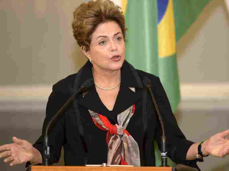 Brazilian President Dilma Rousseff is accused of manipulating government finances to benefit her 2014 re-election campaign. She is shown here at a news conference in Finland in October.