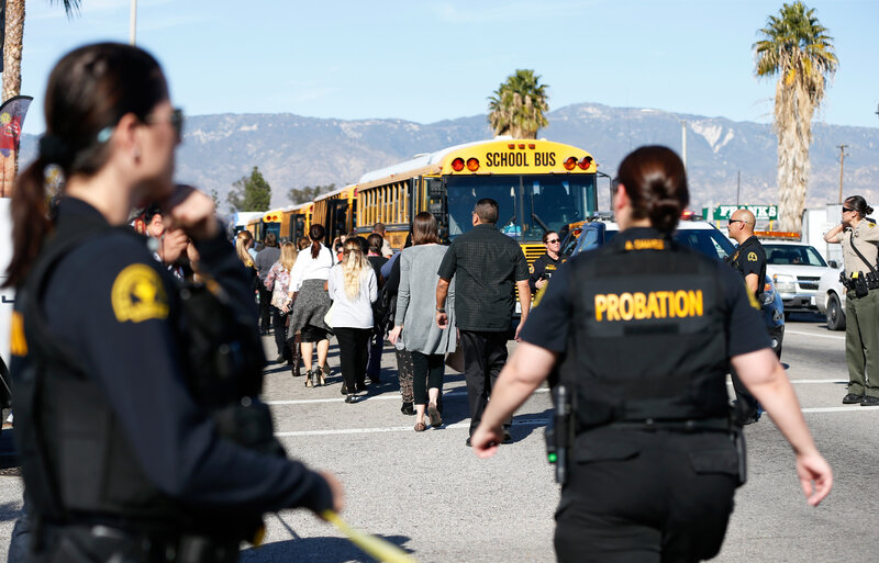 Police officers transport bystanders from the area after at least one person opened fire at a social services agency in San Bernardino, Calif. earlier today. (Mario Anzuoni /Reuters/Landov)