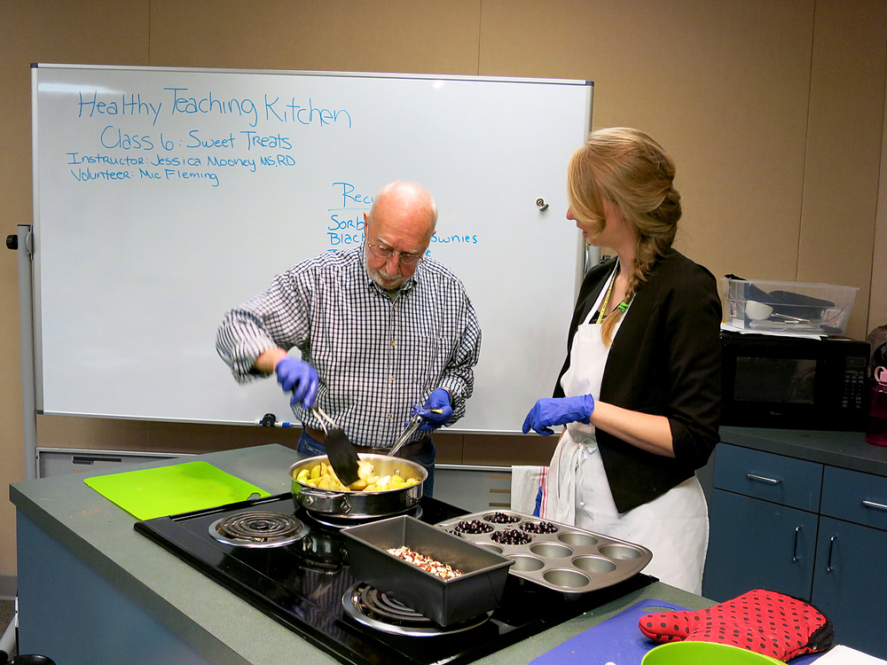 Ray Spaulding cooks apples in front of a class on cooking healthful desserts at the Portland VA withJessica Mooney, right, a clinical dietitian. About 80 percent of veterans are overweight and obese and another quarter have diabetes, according to the Department of Veterans Affairs.