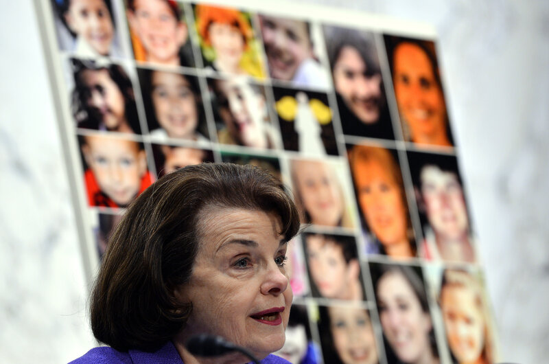 Pictures of the Sandy Hook Elementary School shooting victims are displayed as Sen. Dianne Feinstein (D-Calif.) speaks during at a 2013 Senate hearing. Wednesday's shooting in San Bernardino, which killed at least 14 people, was the deadliest since the 2012 shooting at Sandy Hook, which left 26 people dead.