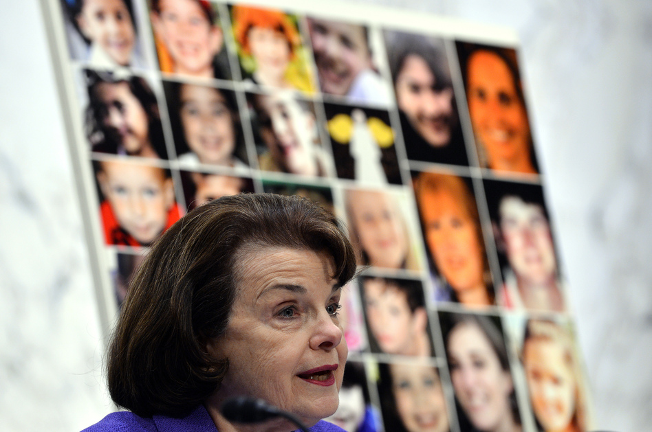 Pictures of the Sandy Hook Elementary School shooting victims are displayed as California Democratic Sen. Dianne Feinstein speaks during a 2013 Senate hearing. Wednesday's shooting in San Bernardino, which killed 14 people, was the deadliest since the 2012 shooting at Sandy Hook, which left 26 people dead. (Jewel Samad /AFP/Getty Images)