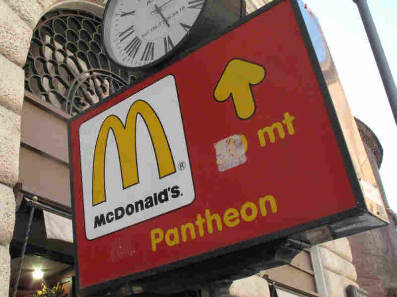 A sign points to a McDonald's restaurant in Rome in 2011. Regulators say the restaurant chain essentially has avoided paying taxes on its European profits for years.
