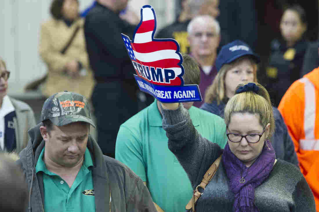 Attendees at a Donald Trump rally in Manassas, Va., take part in a prayer and moment of silence after the San Bernardino, Calif., shootings.