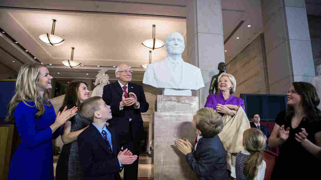 Former Vice President Dick Cheney, along with his wife and grandchildren, look on after Cheney's bust was unveiled at the U.S. Capitol on Thursday.