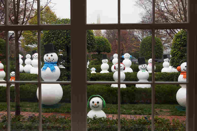 "A collection of 56 ""snow people"" stand outside the East Colonnade. The sculptures represent all 50 states and six U.S. territories."