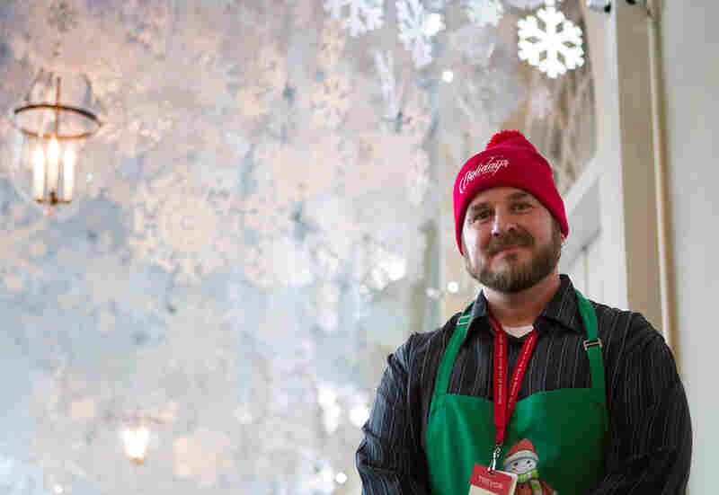 Trevor Smith helped hang thousands of paper snowflakes in the East Colonnade. He runs a landscaping and floral design firm in Boston with his fiancee, Christina Donovan, who was also selected as a volunteer.