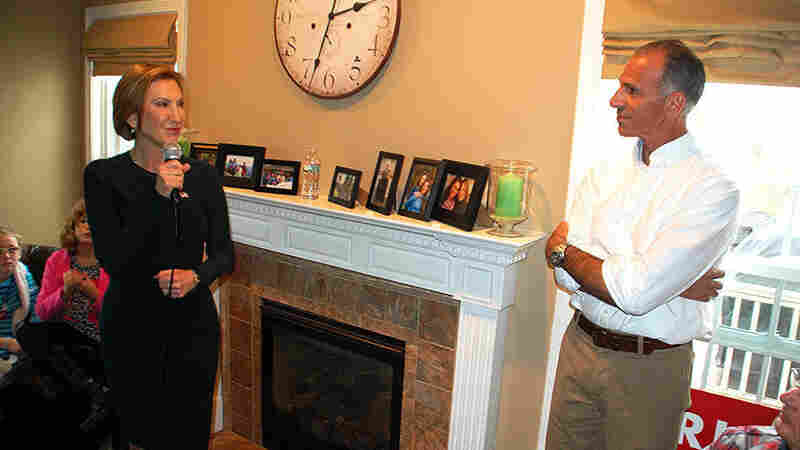 """Carly Fiorina speaks at a house party event at the home of Rich Ashooh (right) in Bedford, N.H. in November. """"Less is more with some of these house parties."""" Ashooh said."""