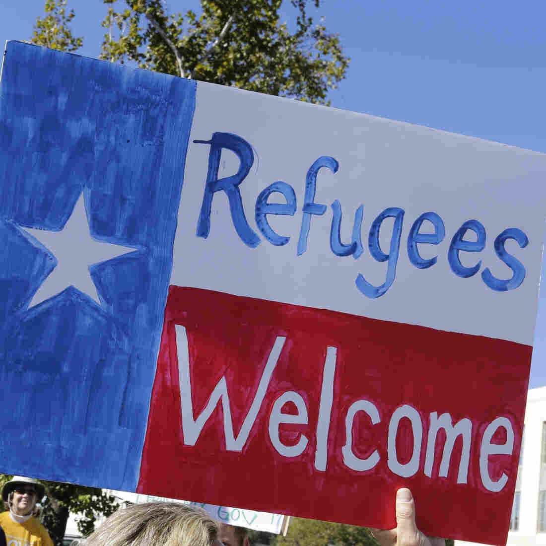 Members of The Syrian People Solidarity Group protest on Nov. 22 in Austin, Texas, after Texas Gov. Greg Abbott announced he'd refuse to allow Syrian refugees in the state. Texas and the U.S. government are now clashing in court over the issue.