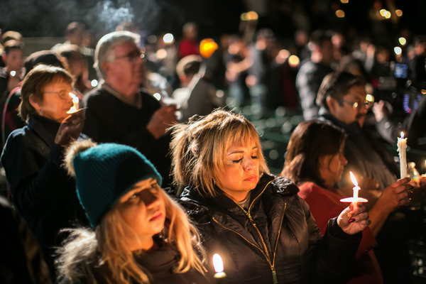 Chelsie Ramirez (left) and her mother, Josie Ramirez-Herndon, join community members during a candlelight vigil at San Manuel Stadium in San Bernardino on Thursday to honor the 14 victims of Wednesday's mass shooting.