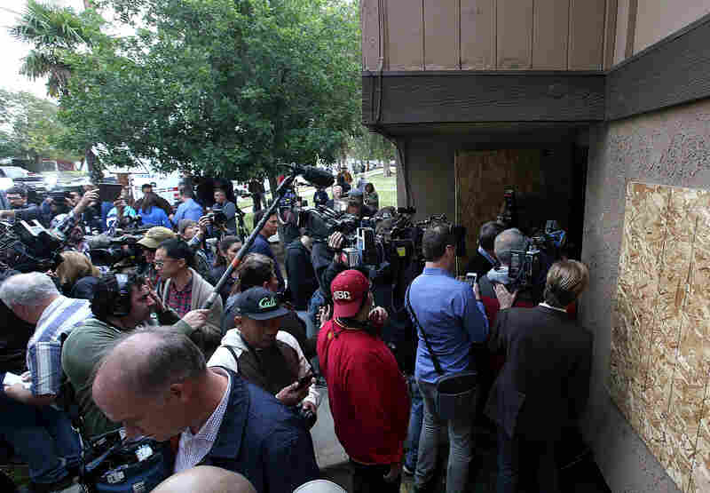 Dozens of members of the media stand in front of the home of shooting suspects Syed Farook and Tashfeen Malik on Friday.