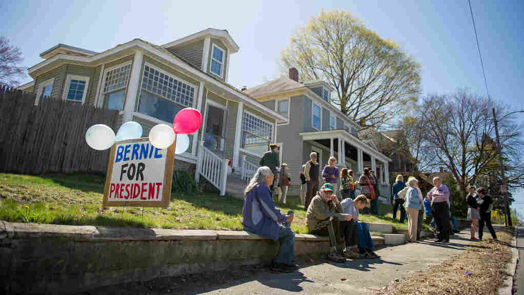 Supporters wait outside a house party for Bernie Sanders in Manchester, N.H.