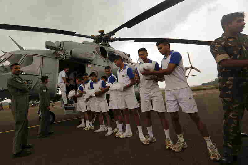 At Chennai's Tambaram Air Force Station, soldiers load food supplies onto a chopper in advance of air-drop on Friday.
