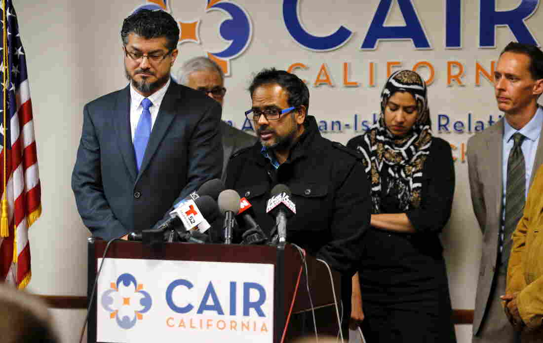 "Farhan Khan, brother-in-law of San Bernardino shooter Syed Farook, speaks at a Council on American-Islamic Relations press conference in Anaheim, Calif., on Wednesday. CAIR called the press conference very early into the investigation of the shooting, to ""get out in front of the story,"" says the organization's communications director."